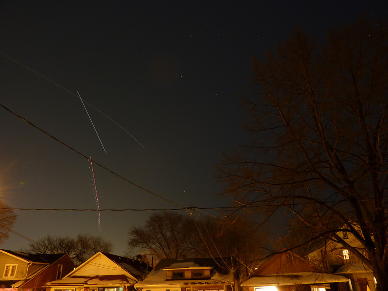 ISS heading east from Toronto, 6:06 PM, Jan. 9, 2010.  A couple of airplanes are chasing it.<br /> Panasonic Lumix, 30 seconds on tripod, 25mm.