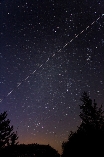 """ISS Fly Over October, 7 2011 6:01 EDT  Andreas Gada, Taken from my driveway.  Composite of three 60"""" images take with a Canon 40D, ISO 1600, 10mm Canon lens at f/3.5."""