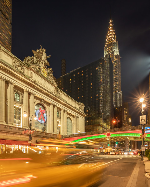 Grand Central Terminal, Chrysler Building, Park Avenue Viaduct, and a speeding taxi at Christmas.