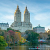 Boaters with the San Remo in the background during the fall in Central Park.