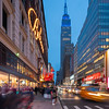 Empire State Building in blue, Macy's Believe Sign, and Macy's Turkey.