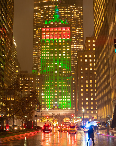 Helmsley Building and its reflection on Park Avenue during a rainy evening.