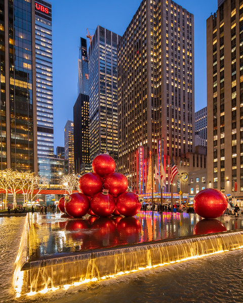 Radio City Music Hall and Large Red Ornament Balls at night.