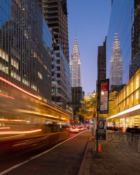 Chrysler Building and a bus speeding by during the blue hour.