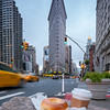 Coffee and a Bagel with Cream Cheese, Taxis, and the Flatiron Building