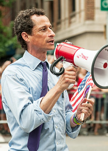 WALKING & RUNNING: Former New York congressman Anthony Weiner marching in the 2013 Gay Pride parade in Manhattan.  A sexting scandal led the Democrat to resign his House seat in 2011.  Two years later he announced his candidacy for New York mayor.