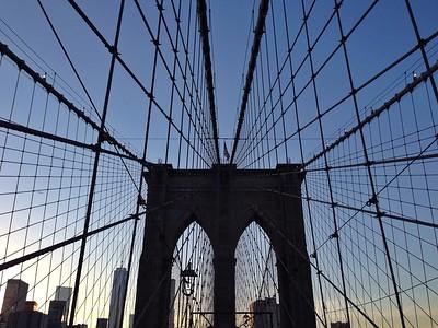 Sun beginning to set along the Brooklyn Bridge