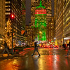 Helmsley Building on Park Avenue with Christmas lights on a rainy evening.