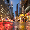 Chrysler Building, its reflection, red brake lights, yellow McDonald's sign and their reflections.
