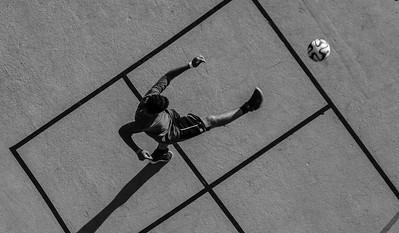 Boy Kicking Ball, West 43rd Street