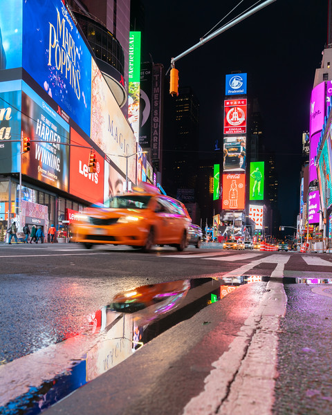 Times Square with Speeding Taxi after the rain.