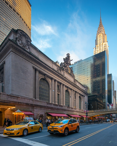 Grand Central Terminal and Chrysler Building with taxis in the foreground.