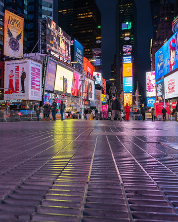 Times Square with grates in the foreground.