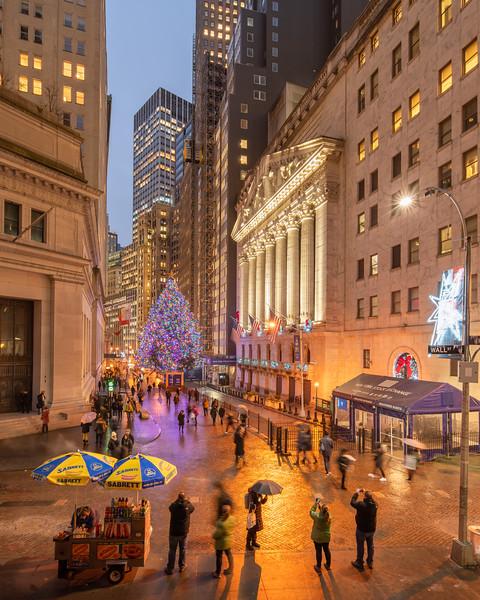 Wall Street, NYSE, and its Christmas Tree on a rainy evening.