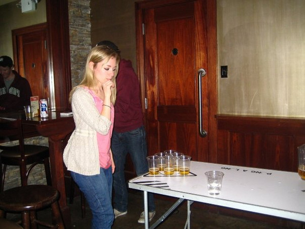 Casey and Pat playing beer pong after midnight on her 21st birthday.