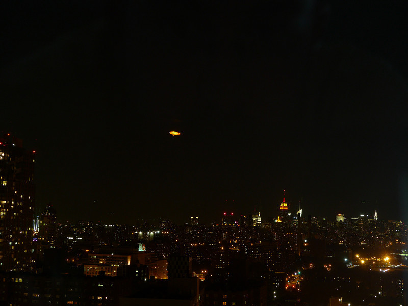 Conan's blimp hovering over the city.