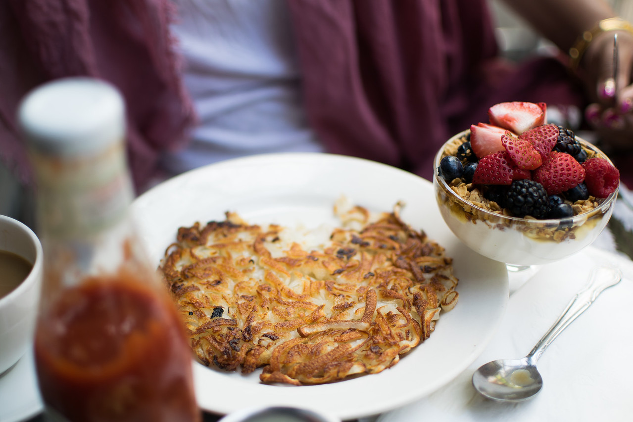potato pancake and granola with fruit at Cafe Orlin
