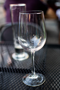 Empty glasses at the Tangled Vine happy hour