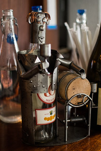 Wine bottle holder on the bar at the Tangled Vine