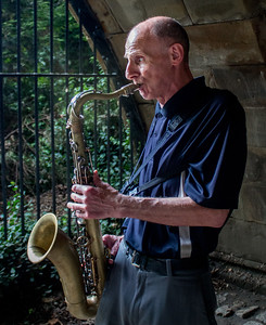 Saxophonist under a bridge in Central Park
