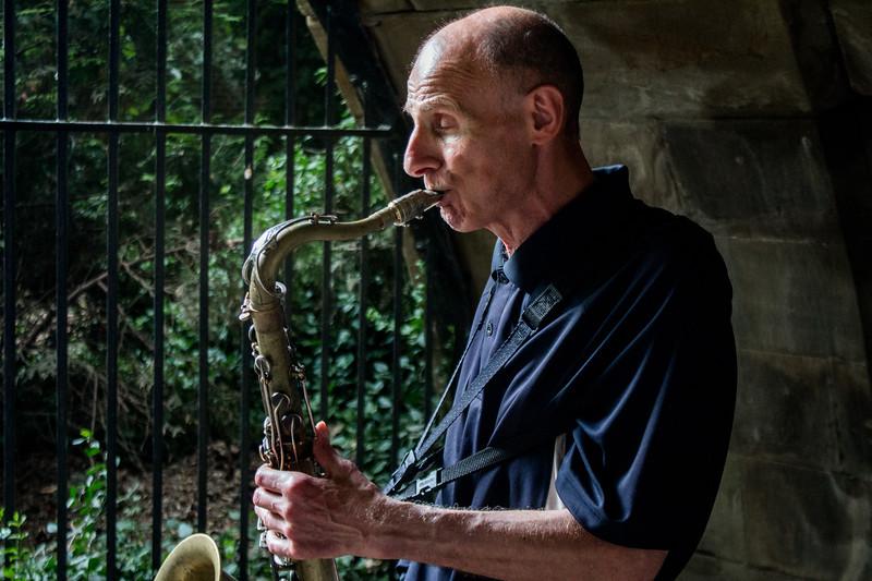 Saxophonist under a bridge in Central Park
