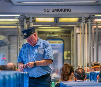Mr Conductor punching tickets