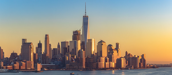 The sun setting over the lower Manhattan skyline