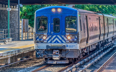 Train arriving Scarsdale, NY from Grand Central Station