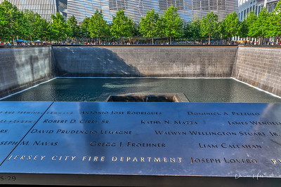 Water cascades down each wall where victims names are all etched in marble