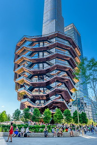 The Vessel is a 16-story, 150-foot-high structure of connected staircases between the buildings of Hudson Yards, located in the 5-acre Hudson Yards Public Square. ... The attached 5-acre public square has 28,000 plants and 225 trees, located on the platform upon which Hudson Yards is built.