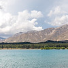 Trees, mountains and Lake Tekapo