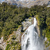 Waterfall and peaks at Milford Sound, Fiordland