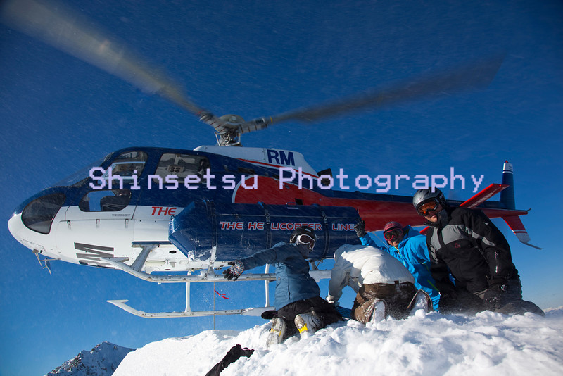 Helicopter dropping off skiers in the Southern Alps