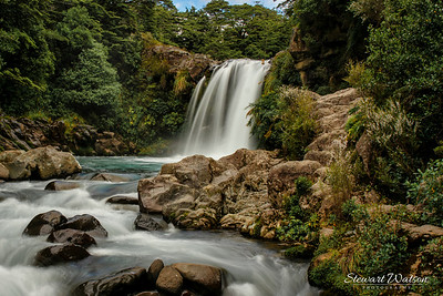 """Tawhai Falls, a rocky forest cascade with a pool for swimming, used as a filming location for """"Lord of the Rings."""""""