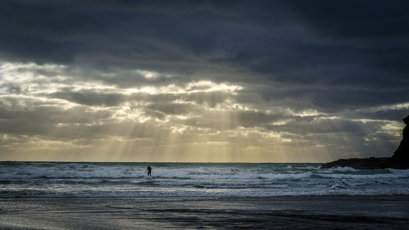 Lone surfer, Bethell's Beach, West coast, Auckland