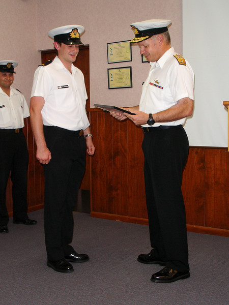 Kris Herbison receives his parchment from Commodore Jack Steer