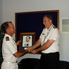 Capt Arnold makes a presentation to Lt Cdr Peter Drew of Ngapona