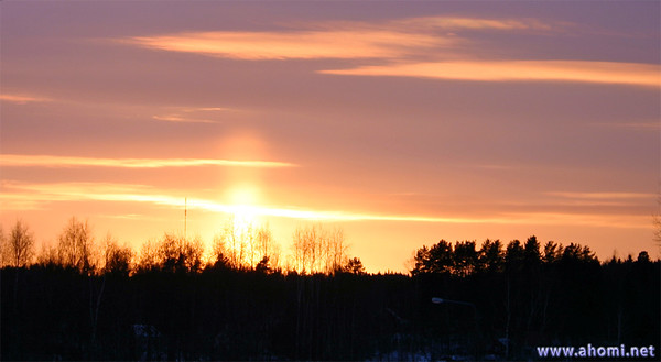Nacreous clouds and sunpillar. Korpilahti, Finland. 11-March 2005.