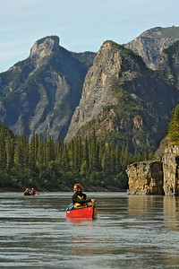 Canoeist Brian Pollock in third canyon on the South Nahanni River. Nahanni National Park is a Unesco World Heritage site. The Nahanni River is also a Canadian Heritage River and one of the world's most popular paddling/canoeing destinations. Northwest Territories (NWT) Canada.