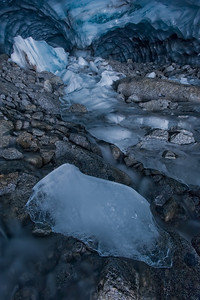 Glacial creek flowing from blue ice cave in the Britnel Glacier. Glaciers across the planet are rapidly melting due to Global Warming.