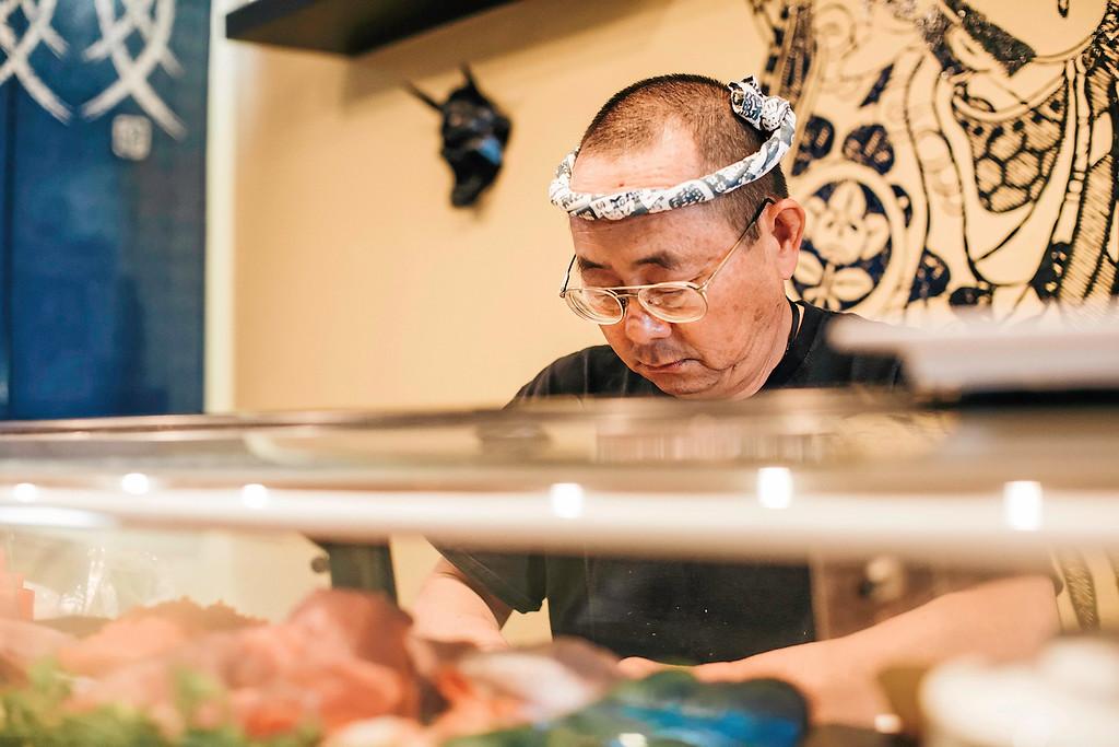 . Owner and chef Masao Nakagawa prepares a complicated Naka #1 Roll with intense concentration. (Carolyn Kelley - Santa Cruz Sentinel)