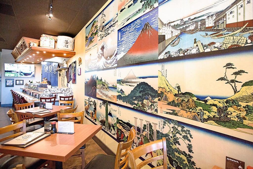. The tastefully decorated interior of Naka Sushi features a wall of traditional Japanese paintings. (Carolyn Kelley - Santa Cruz Sentinel)