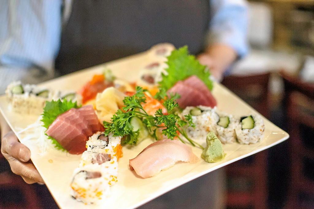 . Assorted nigiri plate with hamachi and cucumber rolls. (Carolyn Kelley - Santa Cruz Sentinel)