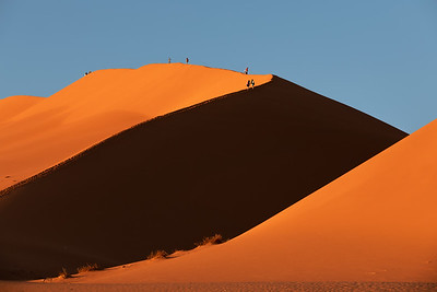 people on dune in Hidden Vlei, Namibia, Africa