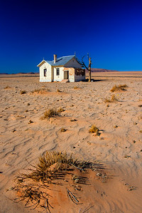 Abandoned railroad station, due to the rapidly shifting sand dunes covering the old tracks.