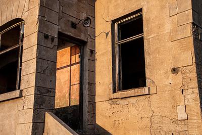 namibia, tsau //khaeb (sperrgebiet) np, kolmanskop, diamond mine, ghost town, architecture, windows, doorways, lamps