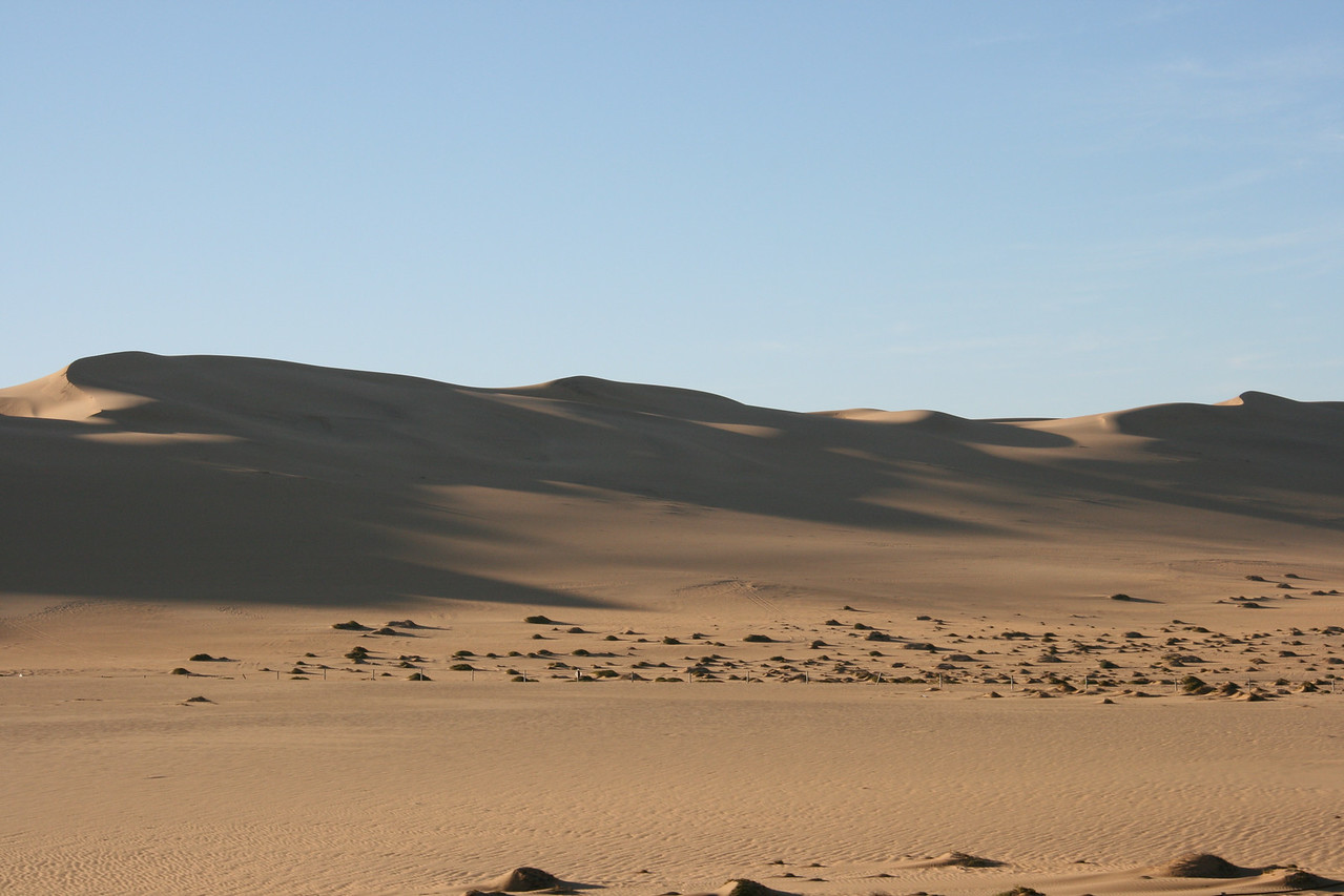 Dunes coming down to the sea between Swapo and Walvis Bay, Namibia