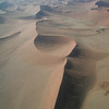 Low level flight over the dunes of the Namib-Naukluft desert towards the Skeleton Coast