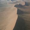 Low level flight over the dunes of the Namib-Naukluft desert towards the Skeleton Coast