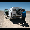 Me changing a blown tyre in the desert.